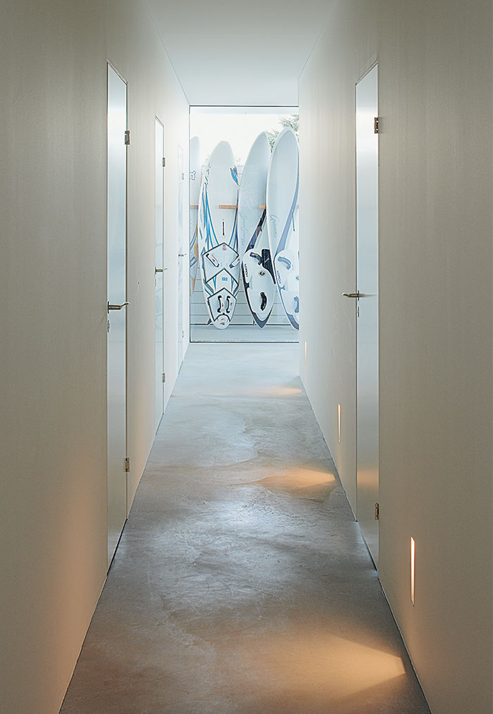 Modern Swedish family dream getaway with hallway and surfboards