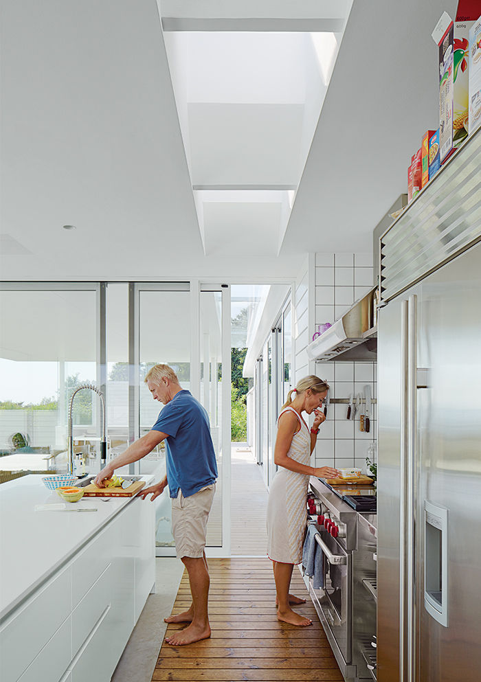 Modern Swedish family dream getaway with corian Multiform top and Wolf hood and oven in the kitchen