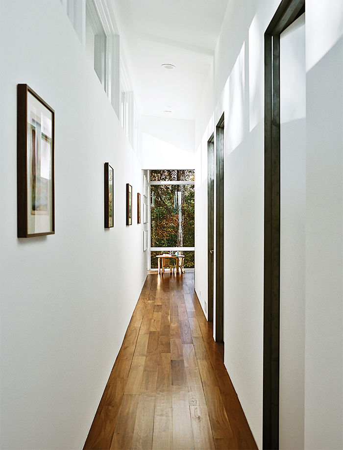 Modern home in North Carolina with walnut plank flooring and bentwood table chairs by ECR4kids in the hallway