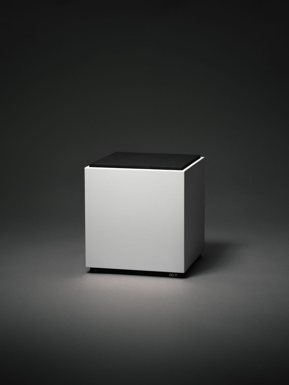 Minimalist cube speaker with black grille