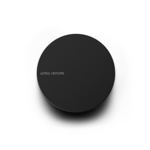 Simple circular remote with magnetic base