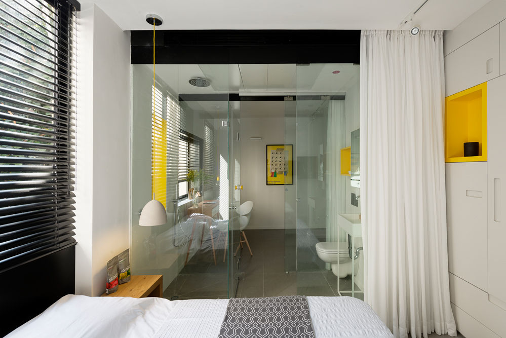 Tiny Tel Aviv Apartment glass walls separating spaces