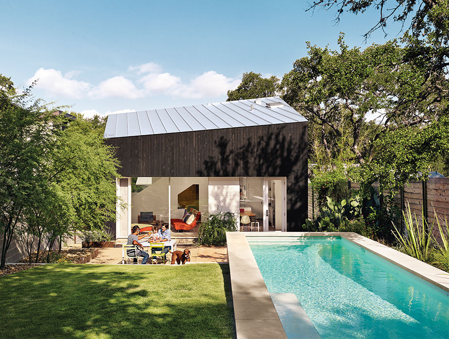 Modern Texan addition and renovation with outdoor pool and cypress paneling and metal roof