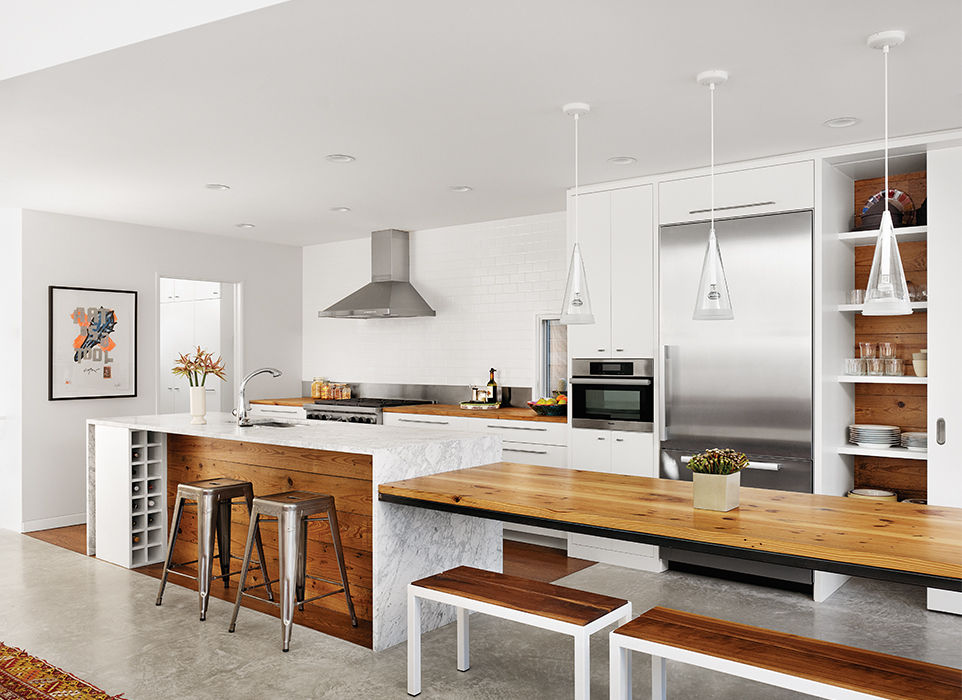 Modern Texan addition and renovation with marble island and integrated wood in the kitchen