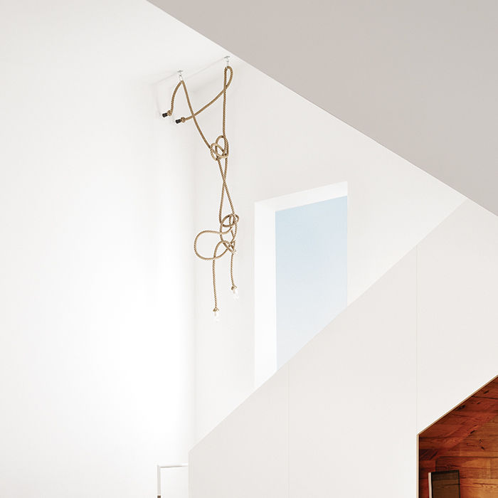 Modern Texan addition and renovation with stairway rope chandelier