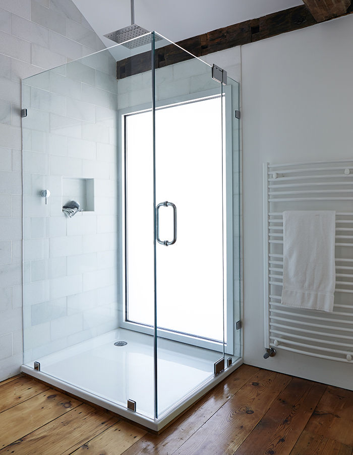 Modern glass shower in the Twisted Farmhouse bathroom