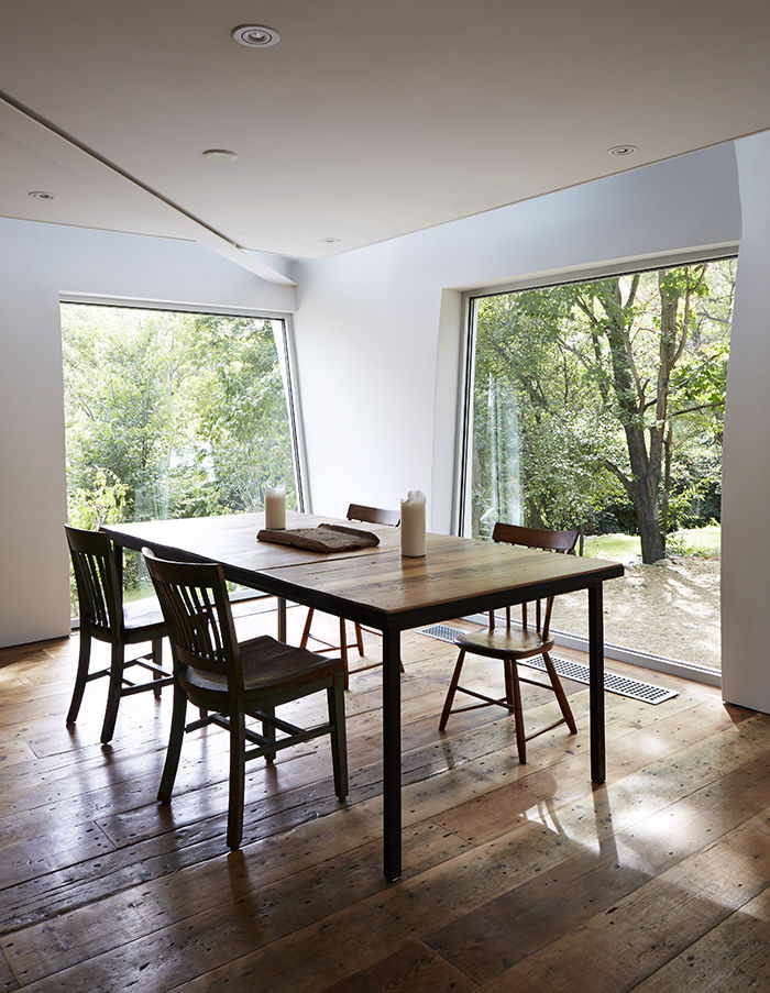 Dining table and chairs with large windows