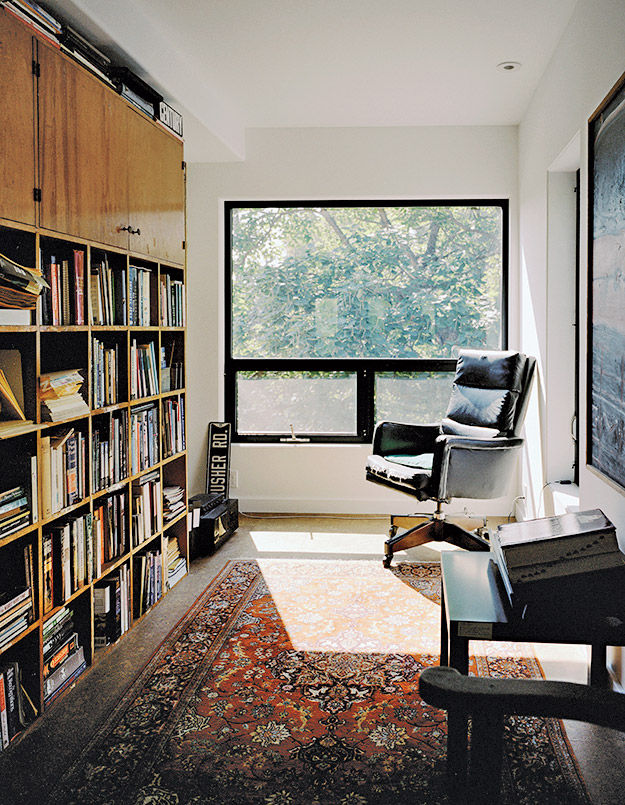 Antique armchair in office of shipping container home in Pennsylvania off the Delaware River