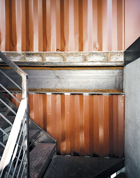 Stairway with shipping container details in shipping container home in Pennsylvania off the Delaware River