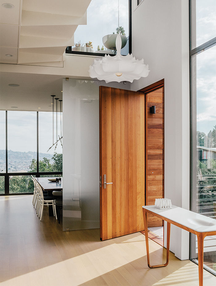 Modern renovation in San Francisco with chandelier and catwalk in the entrance