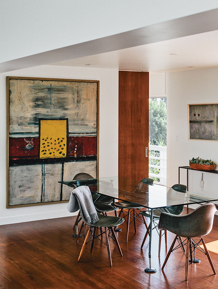 Modern Los Angeles renovation by Don Dimster with Norman Foster dining table and Eames chairs in the dining room
