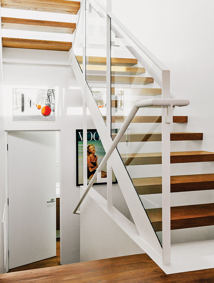 modern Los Angeles renovation by Don Dimster with steel and glass stairway with open treads