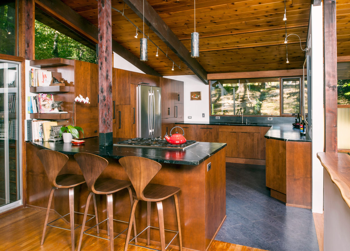 Cherner barstools, cherry-stained alder cabinets, and soapstone countertops.