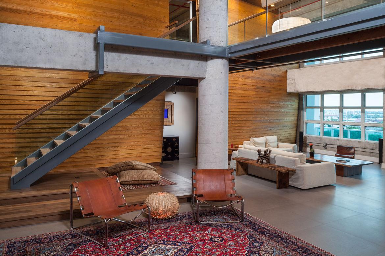 Warped wooden wall in Miami loft renovation.