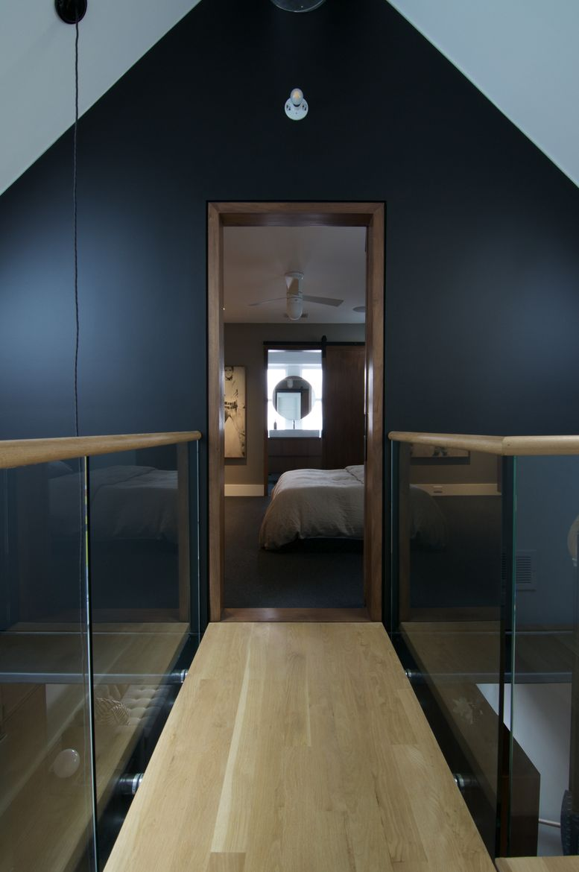 """Floating"" walkway to bedroom in Chicago renovation."