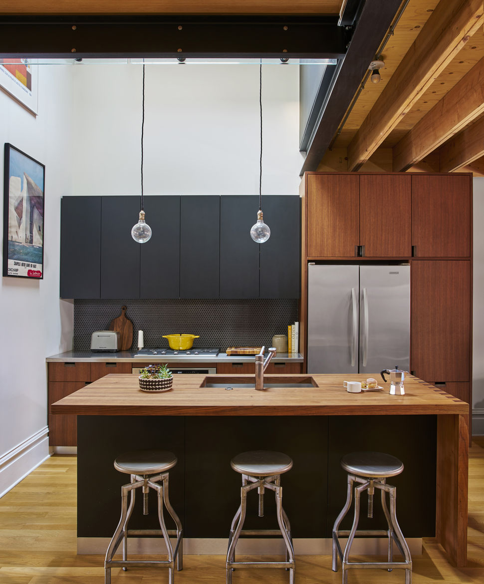 Schoolhouse Electric & Supply Co. pendant lights and expandable table in Chicago renovation.