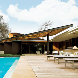 Modern house with ipe pool terrace and Douglas fir trellis