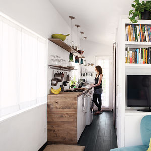 Narrow gallery-style kitchen with wood details