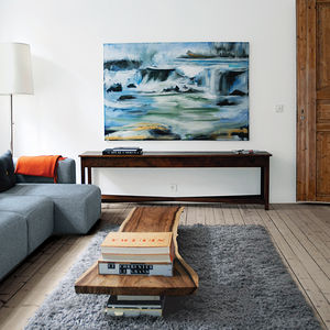 Oslo living room with light wood floors and wood slab table