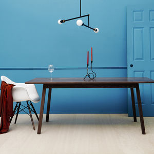 Solid walnut dining table by Brush Factory