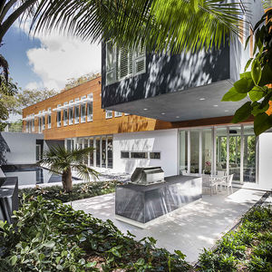 Outdoor kitchen and dining room in Miami