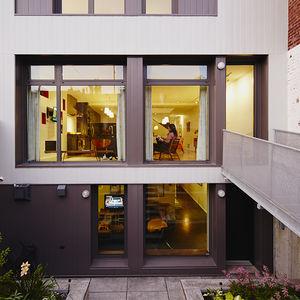 home for good renovation montreal family rear facade steel cladding footbridge garden