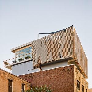 natural preservatives charleston south carolina warehouse addition facade fiberglass louvers