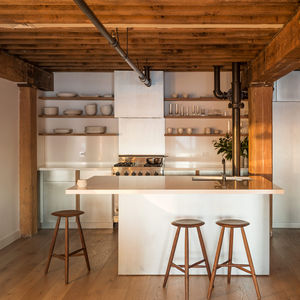 new york accent manhattan loft renovation kitchen zinc cabinets quartzite countertops fir beams saw kille counter stools white oak lv wood flooring viking range