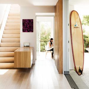 verdant in venice california bungalow indoor outdoor family fleetwood aluminum panel door staircase