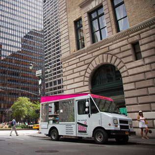 ice cream truck near tall buildings in new york city