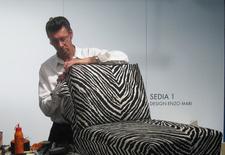 At the ICFF in New York, Aki Lehtonen, a veteran employee of Artek, puts the finishing touch on an Aalto Armchair 400.