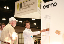 "Cerno's Dan Wacholder shows off the ""Cubo"" lamp at Dwell on Design in 2010."