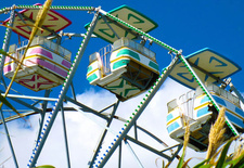 "This photo by <a href=""http://www.flickr.com/photos/michelledwright/"">Michelle Wright</a> highlights the bright colors of the rides and gives a cheery impression of the place."