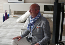 Lissoni is interviewed on his Extrasoft modular sofa in white, defined by its geometric configuration and irregular contours.