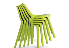 modern green chair by emeco and philippe starck made from recycled materials