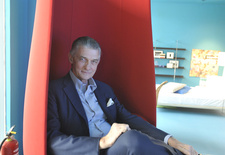 portrait of giulio cappellini in marcel wanders tulip chair