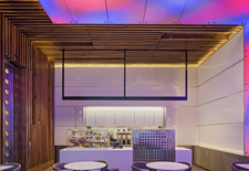Renovation of Ground Cafe at Yale University's Becton School by Bentel and Bentel Architects incorporates neon color in contrast to concrete and walnut paneling.