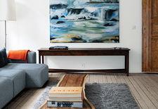 Oslo living room with light wood floors and wood slab table