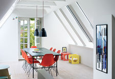 Copenhagen renovation attic with Eames chairs.
