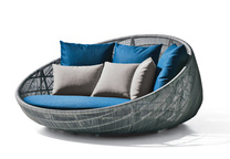 a blue sofa with a metal frame