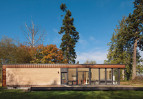 Cedar and Cor-Ten steel compact prefab