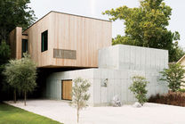 heart of stone houston texas facade concrete wall siberian larch cladding