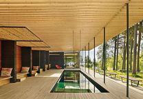 Swedish guesthouse pavilion with pergola over the pool and george nelson benches