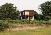 outside providence family summer home rhode island facade cypress cladding marsh