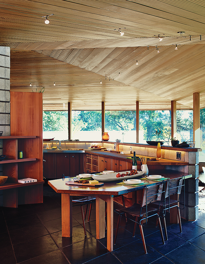 modern home renovation in Napa includes redwood and concrete kitchen seating area with herman miller chairs