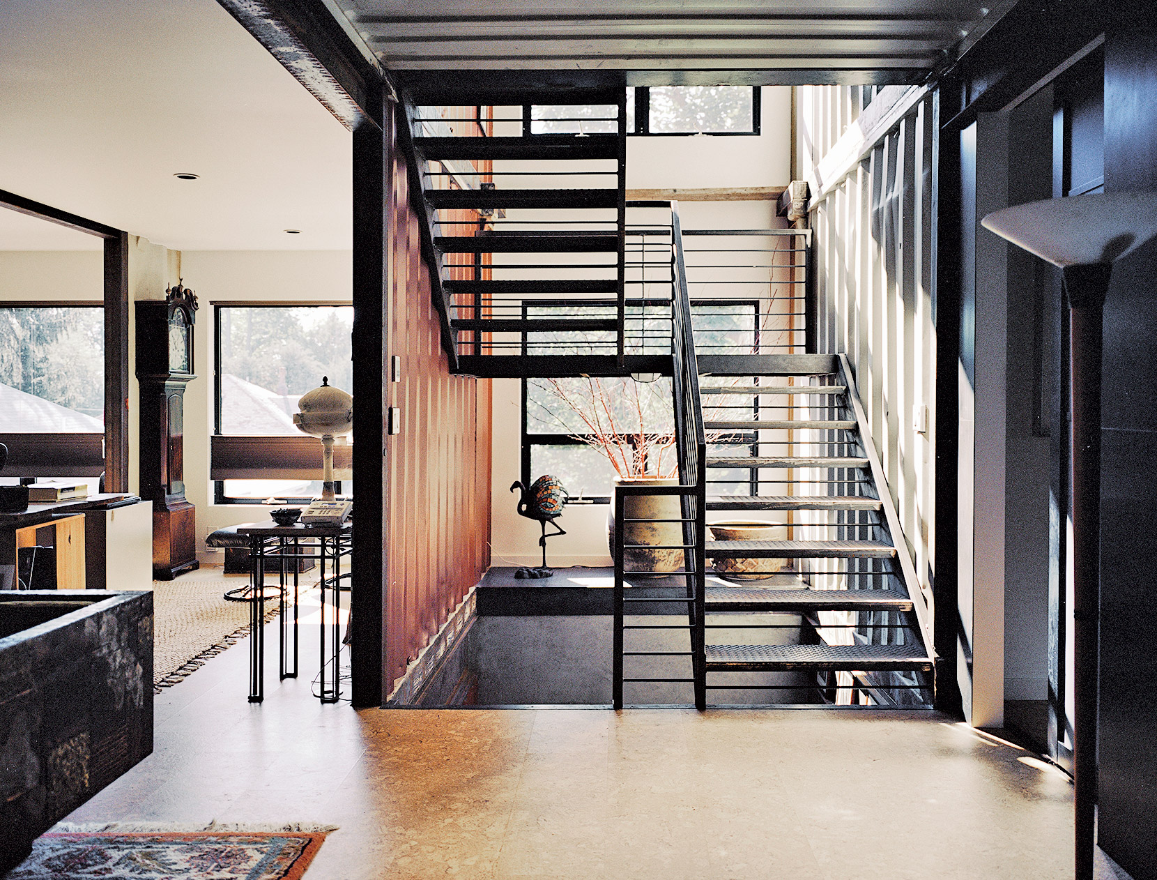 Industrially-styled stairway of shipping container home in Pennsylvania off the Delaware River